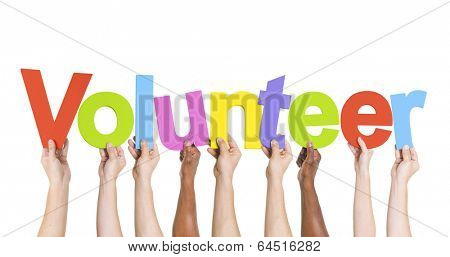 Diverse Hands Holding The Word Volunteer