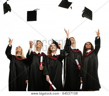 Happy multi ethnic group of graduated young students throwing hats isolated on white