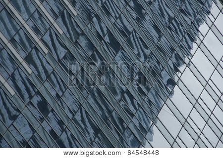 Reflections of building in mirrored glass skyscraper poster