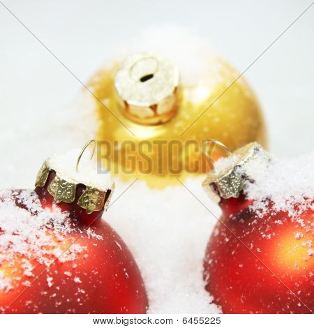 Close-up Of Red & Gold Christmas Balls In White Snow (shallow Dof)