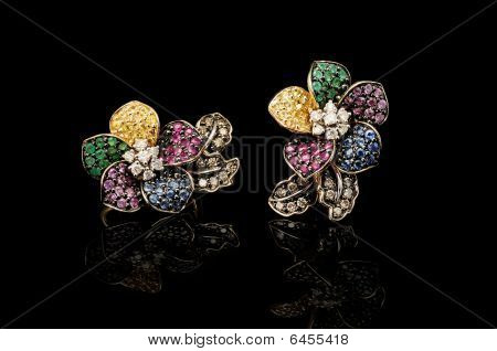 Gold earrings with color gems