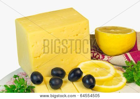 Big Piece Of Cheese, Lemon And Olives On A White Background.