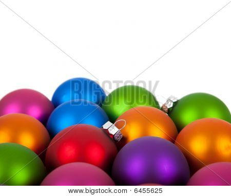 Multi-colored Christmas Ornament/baubles On White With Copy Space