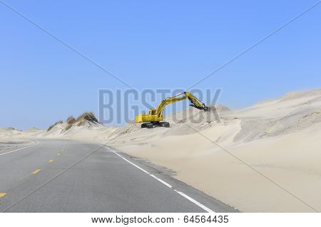 Backhoe Working on Beach Erosion