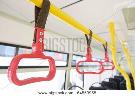 Handles for standing passenger inside a bus