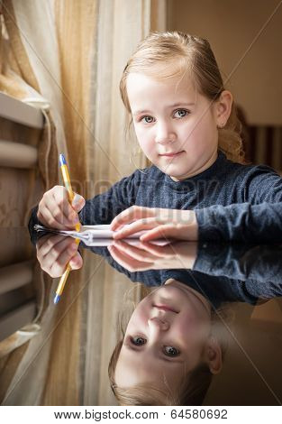 First Grader Girl Writes a pen