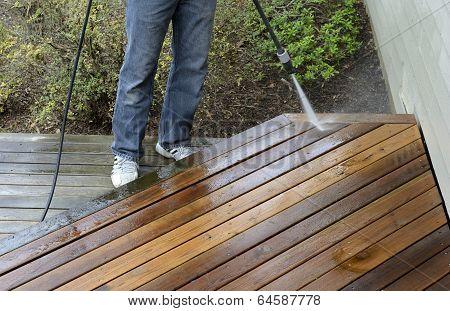 Man Power Washing Deck