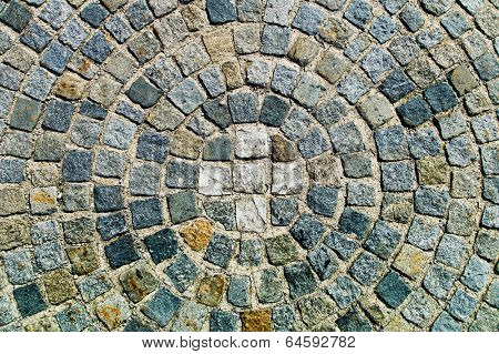paving stones in a circular arrangement, symbol photo for order, conformity and group pressure
