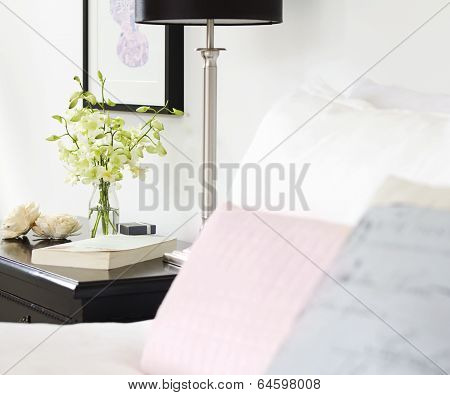 Orchids In Vase On Pretty Bedside Table With Text Space