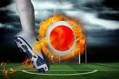 Football player kicking flaming japan flag ball against football pitch under stormy sky poster