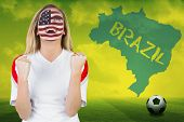 Excited fan in usa face paint cheering against football pitch with brazil outline and text poster