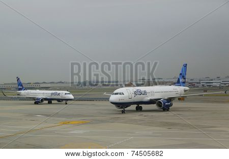 JetBlue Airbus aircrafts taxing at John F Kennedy International Airport in New York