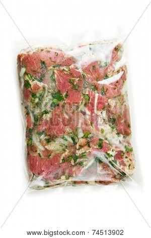 barbecue meat in vacuum marinade bag poster