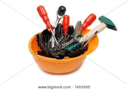 Building Tools In An Orange Helmet
