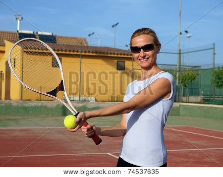 Happy woman playing tennis