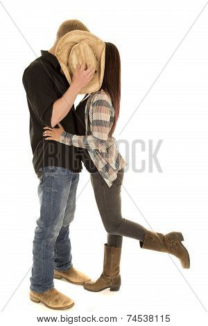 Couple Kiss Behind Hat Leg Up
