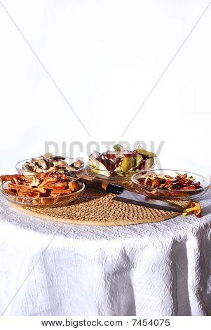various mushrooms arranged od plates