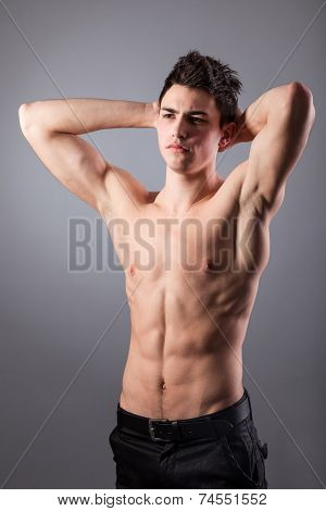Portrait of young bodybuilder man on a black background poster