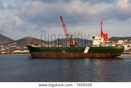 A Crane Working On A Ship In Port