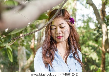 Filipina Woman In A Garden