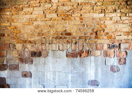 Old brick wall with the damaged plaster. poster
