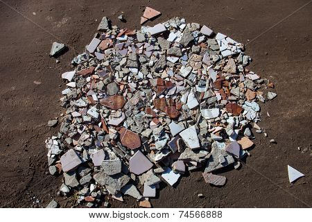 The heap of beaten tiles and concrete blocks. poster