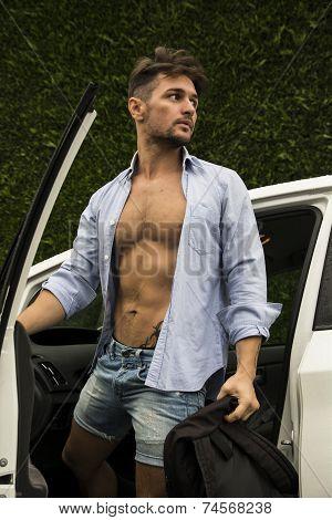 Gorgeous Man In Beach Attire Getting Out His Car