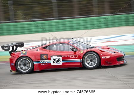 ASSEN, NETHERLANDS - OCTOBER 19, 2014: Ferrari at full speed during the supercar challenge and GT cup during Acceleration 2014 at the TT Circuit in Assen