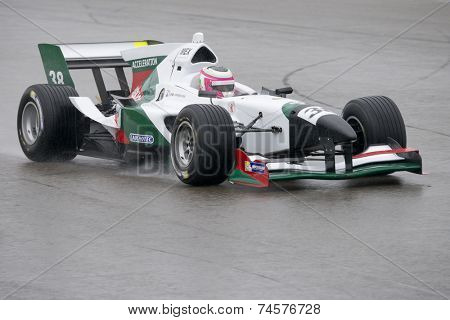 ASSEN, NETHERLANDS - OCTOBER 19, 2014: Team Mexico's car racing on a wet TT circuit during the final race of the acceleration FA1 Grand Prix European Circuit.