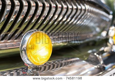 Yellow Head Light Of Retro Car And Radiator Grille.