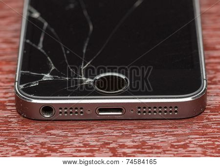 MOSCOW, RUSSIA - OCTOBER 6, 2014: Photo of a broken iPhone 5. iPhone 5 is a smartphone developed by