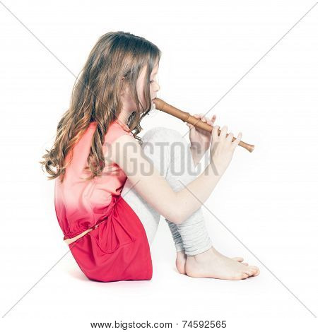Young Girl Sitting With Soprano Recorder