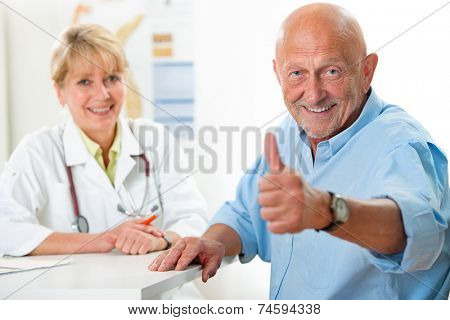 Happy senior patient and doctor at the doctor's office