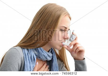 Young woman using an asthma inhaler as prevention