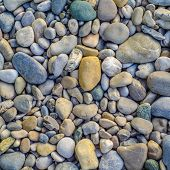 Background Texture Of Beautiful Smooth And Colorful River Stones poster