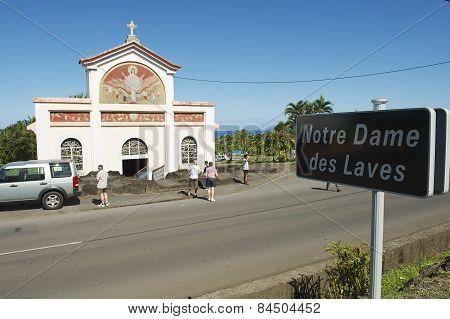 People explore the Notre dame des laves church in Sainte-Rose De La Reunion, France.