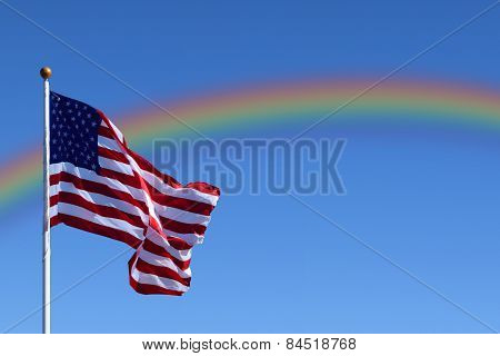 American Flag with Rainbow in Sky