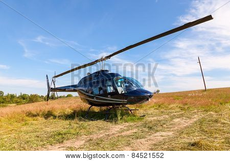 Helicopter Bell Jet Ranger Iii Standing On Field In Summer Sunny Day