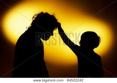 Two  Expressive Boy's Silhouettes Showing Emotions Using Gesticulation