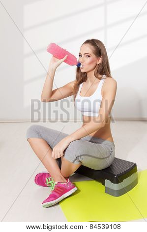 Woman Drinking During Workout