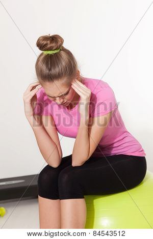 Woman With Headache During Workout