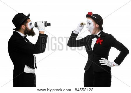Two Memes As Business People Looking At Each Other Through Binoculars