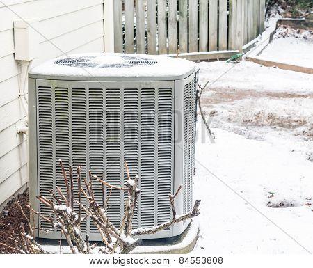 Air Conditioner Unit In The Snow