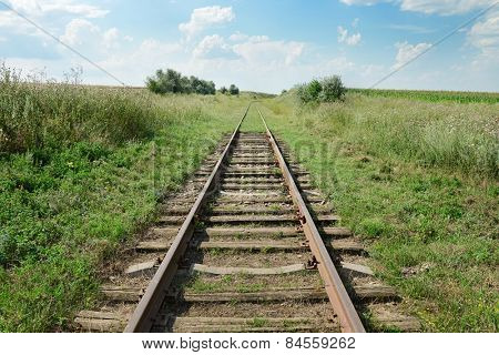 disused railway track on the field