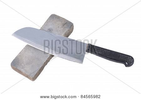 Sharpening Or Honing A Knife On A Waterstone, Grindstone On The White Background