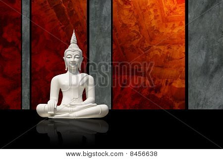 White Buddha, isolated against dark colorful background (incl. clipping path)