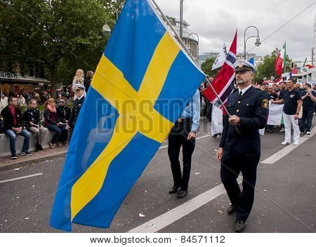 Policeman With The Swedish Flag, During Gay Pride Parade