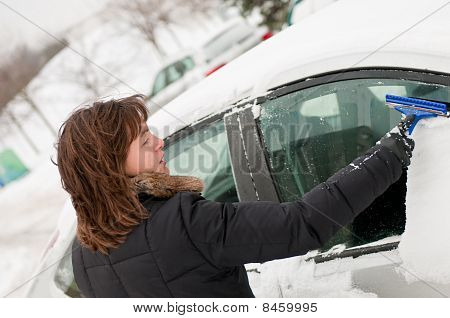 Winter Time - Person Cleaning Car