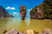 Khao Phing Kan featuring the 20m tall islet known as Ko Tapu in Phang nga bay in thailand. It is also known as the James Bond island after the 1974 James Bond movie - The Man with the Golden Gun was shot here. poster