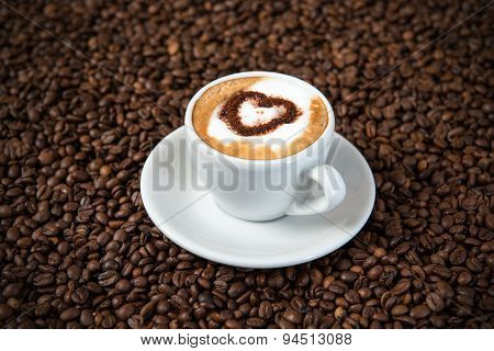 Cappuccino On A Lot Of Coffee Beans
